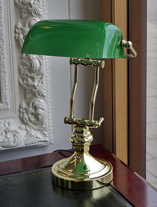 Brass Bankers lamp twin support with green glass shade, English .