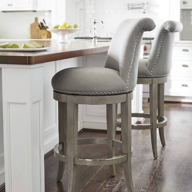 The graceful silhouette and curved back of our Ellison Barstool .