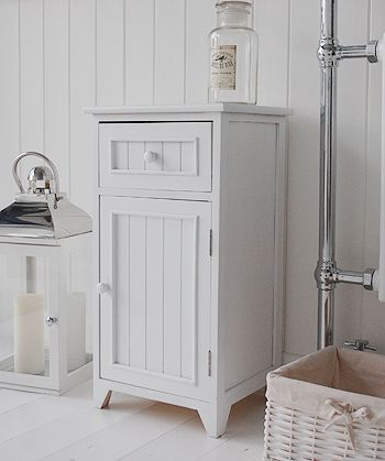 A crisp white freestanding bathroom storage furniture. A narrow .