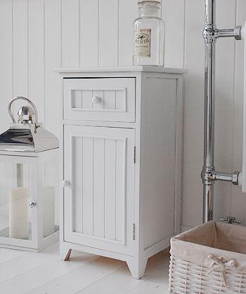 A crisp white freestanding bathroom storage furniture. A narrow .