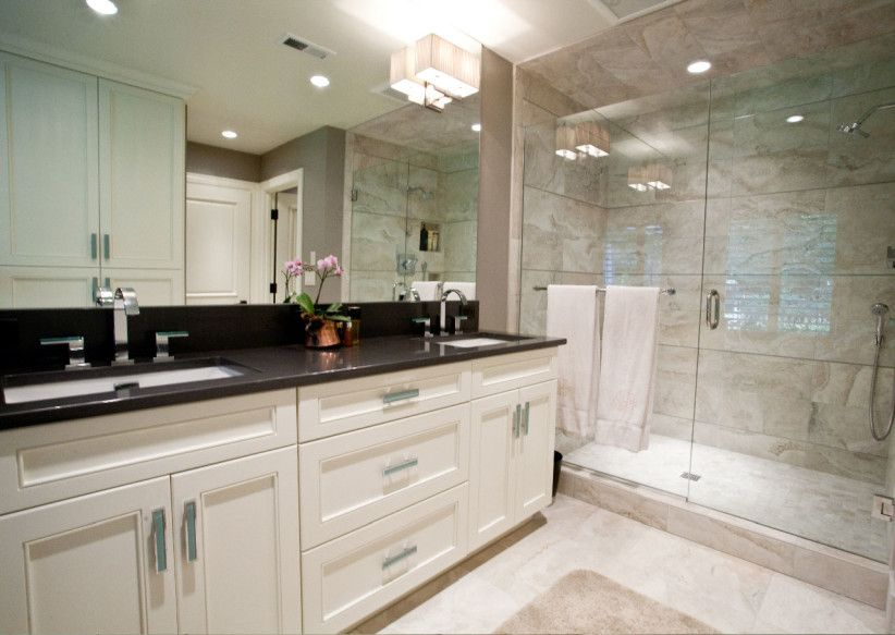 Black granite top over white bathroom vanity | Black vanity .