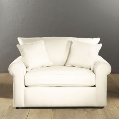 Oversized chair that has a fold out twin bed. What a great idea .