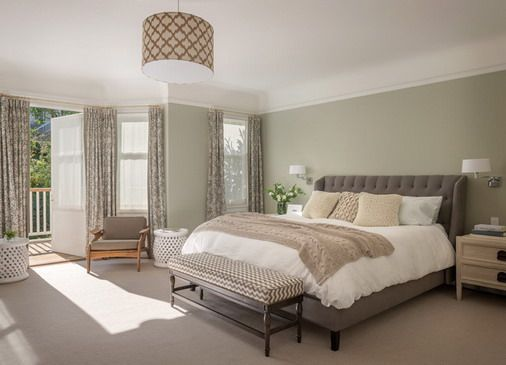 Calm and Warm Wall Colors with Soft Carpets in Small Bedroom .