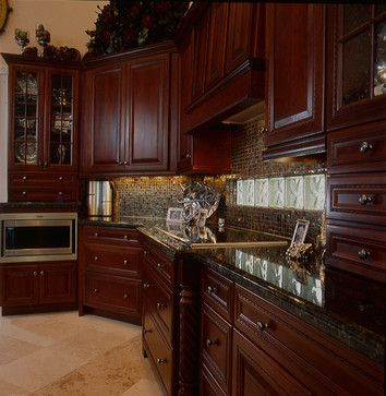Cherry wood cabinets and dark granite tops | Black granite kitchen .
