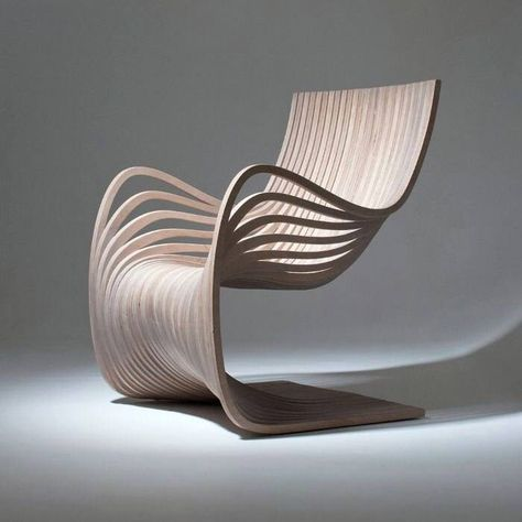 Wooden Chair Showing Movement and Material Conscious Design .
