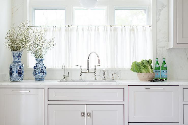 Sheer Cafe Curtains on Windows Over Kitchen Sink - Transitional .