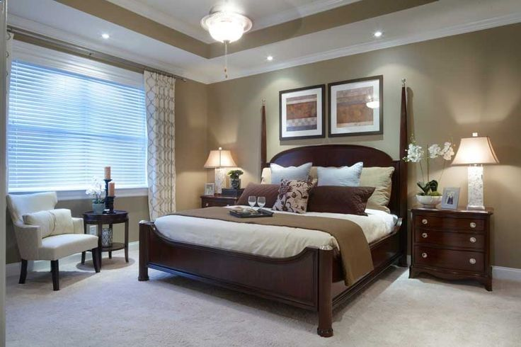 Great master bedroom: Wall color (with white molding); dark wood .