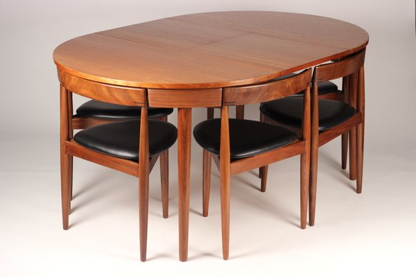 Extendable Dining Table with 6 Chairs by Hans Olsen for Frem Røjle .