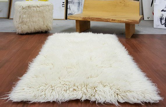 "EXTRA-ORDINARY 3x5 Natural white flokati rug. Boasts a 4"" shag ."