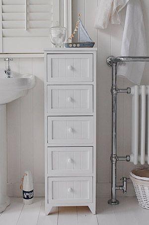 A crisp white freestanding cottage bathroom storage furniture. A .