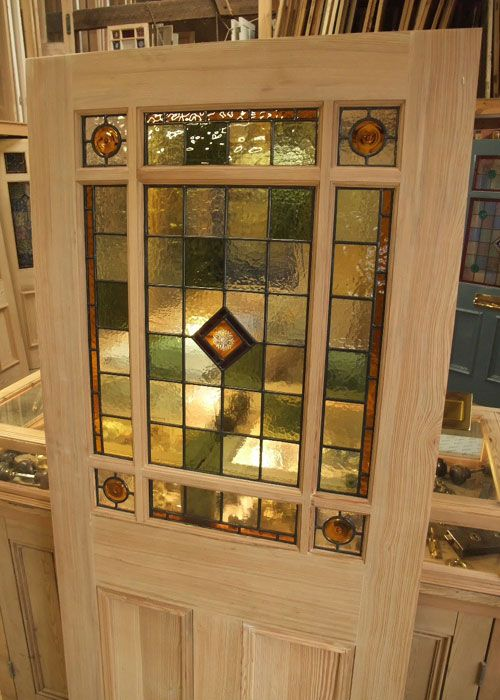 An interior door design with simple pattern stained glass panel in .