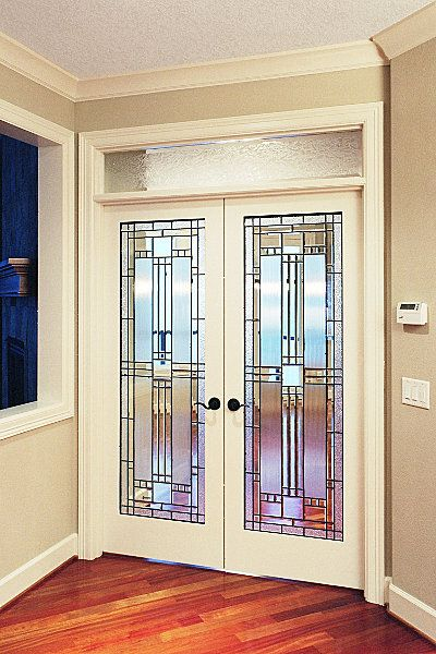 Leaded glass french doors contrast with Brazilian cherry flooring .