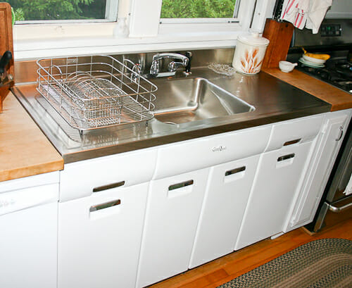 8 vintage style Elkay drainboard sinks for a midcentury kitchen .