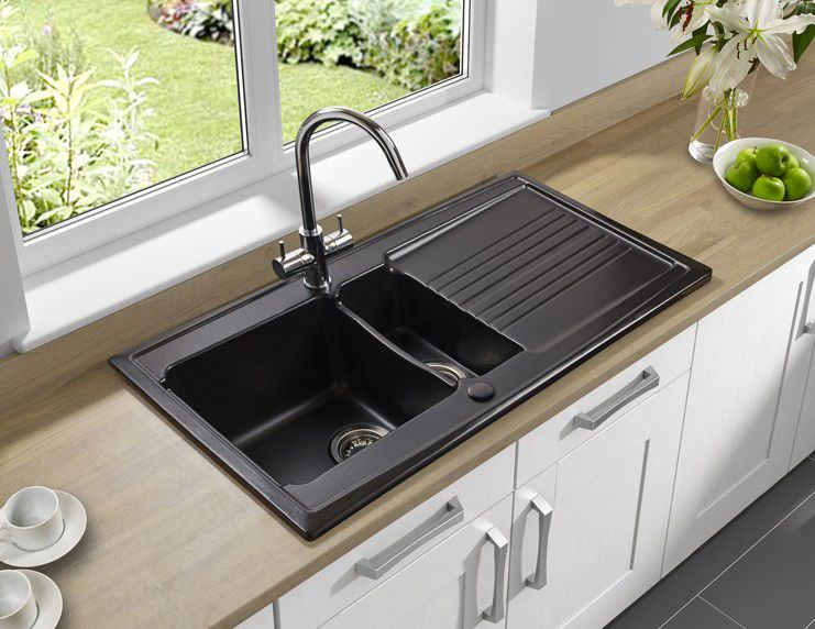 Double kitchen sink / ceramic / overmount / with drainboard .
