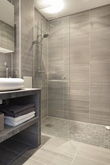 Shower - Small bathroom....like tiles on shower floor and walls of .