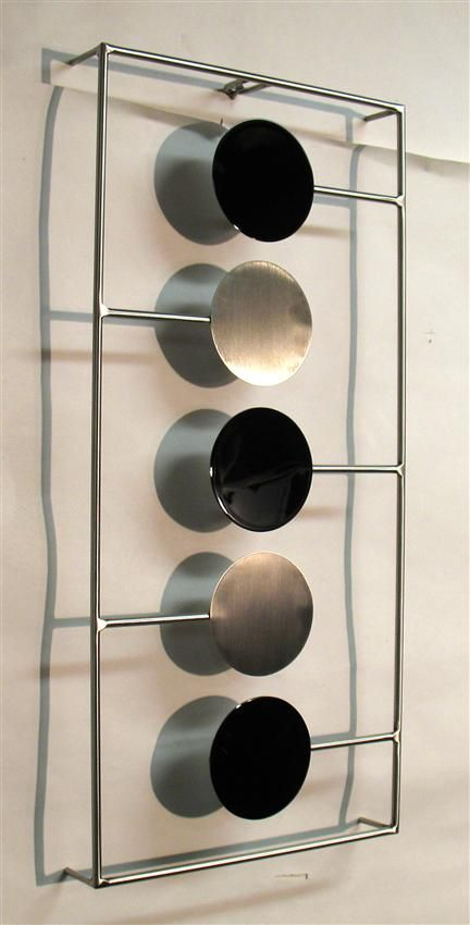 Contemporary metal wall art sculpture - gloss black and brushed .
