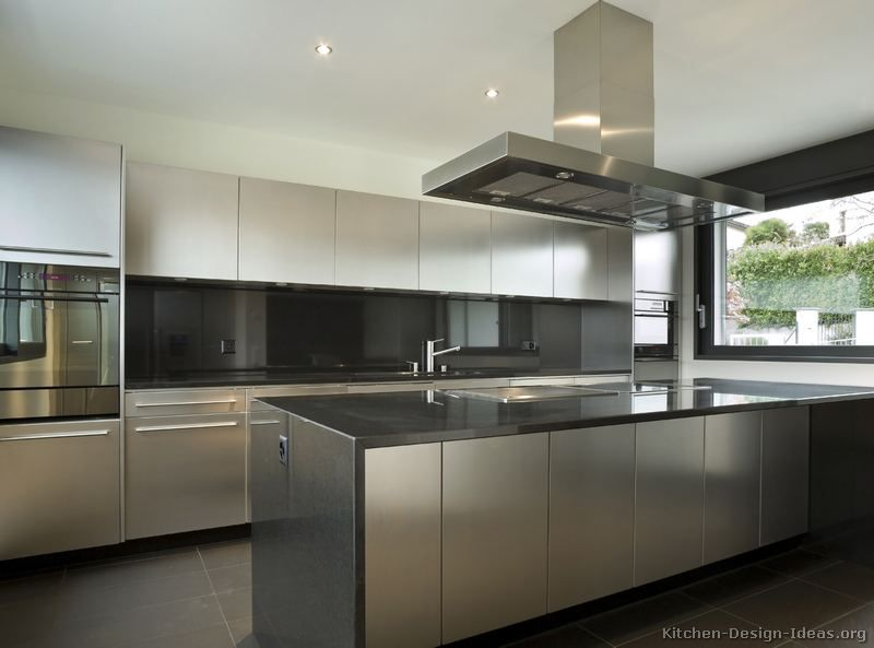 Stainless Steel Kitchen Cabinets with Black Granite Countertops .