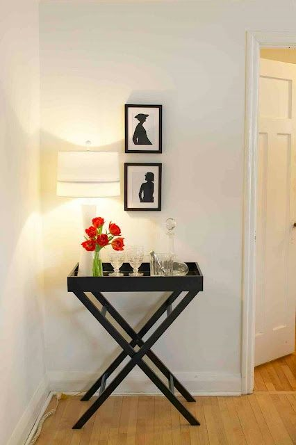 Simple Tray Table Entryway - for our extra folding tray tables .