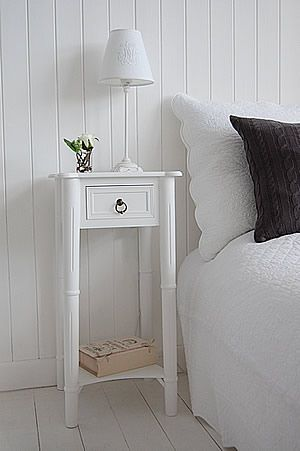 Tall, narrow bedside table to go with tall bed. New England white .