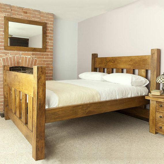 Handmade chunky solid wood plank post slatted bed frame in single .