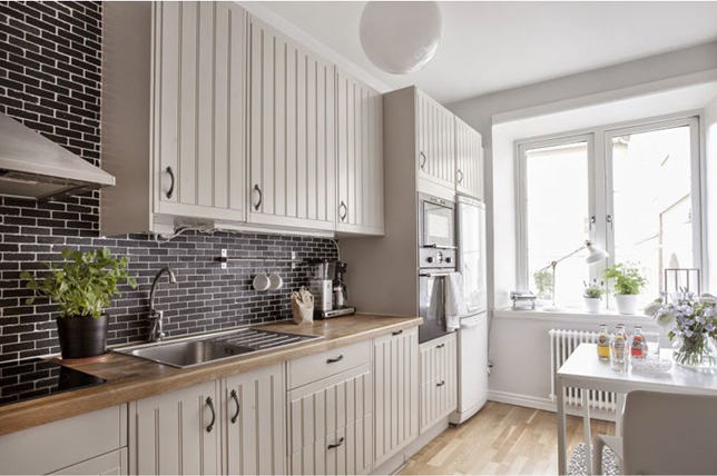 neutrally lacquered kitchen cabinets