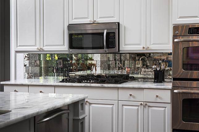 mirrored tile kitchen backsplash