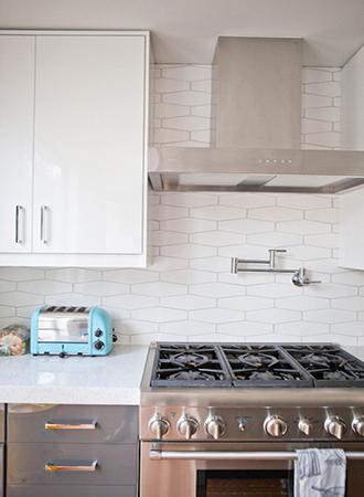 uniquely shaped tile kitchen backsplash