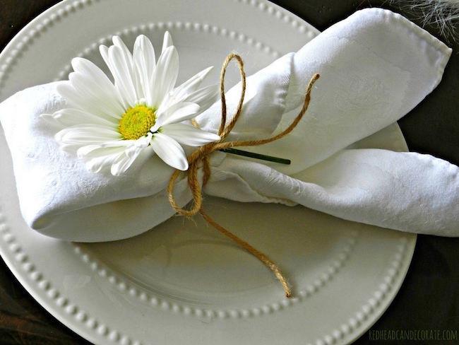 Daisies tied around napkin
