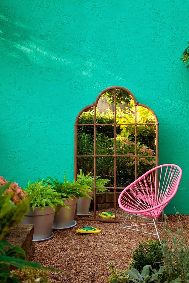 green wall vintage arched mirror pink chair
