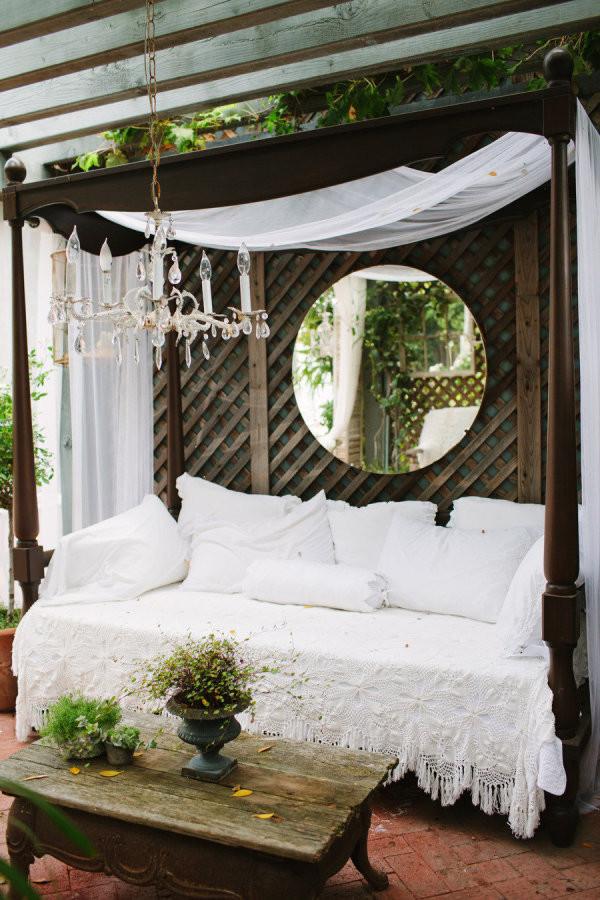 Wooden bed day bed white linen round mirror chandelier