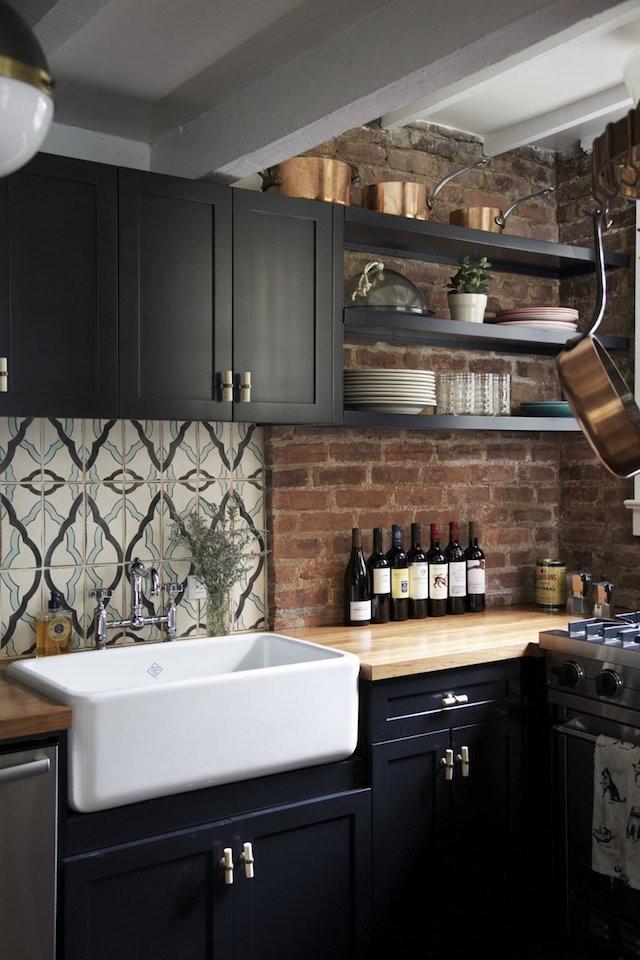 exposed brick black kitchen