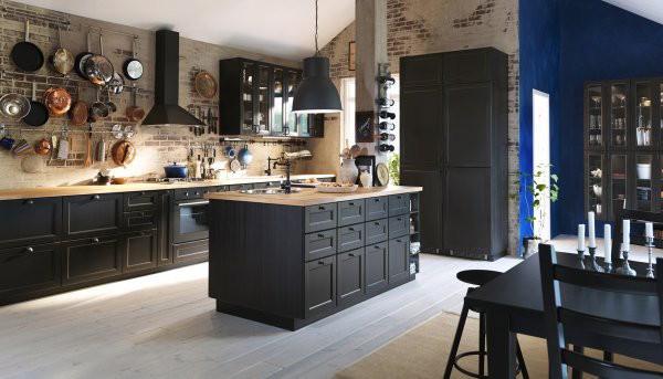 exposed brick black island kitchen