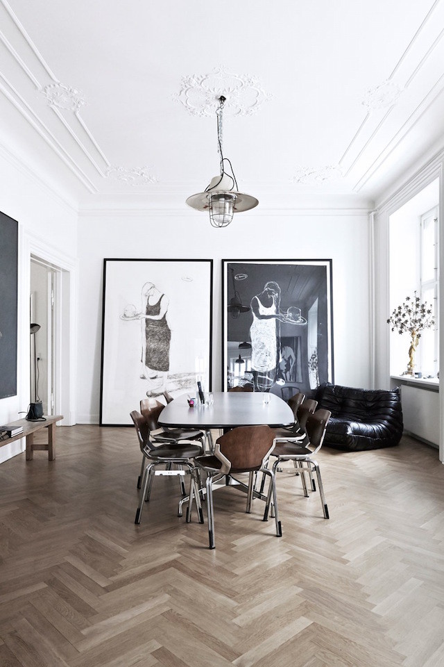 large black and white prints in the dining room