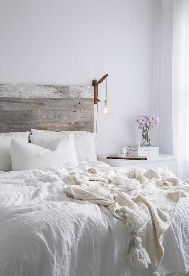 white bedroom reclaimed wood headboard linen bedding