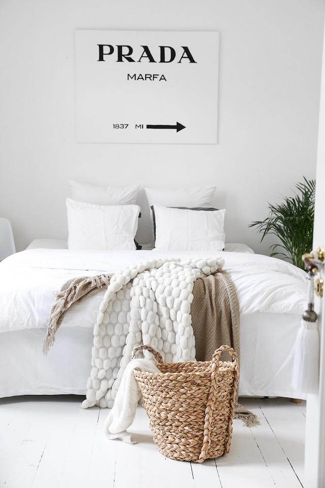 white bedroom Prada Marfa sign