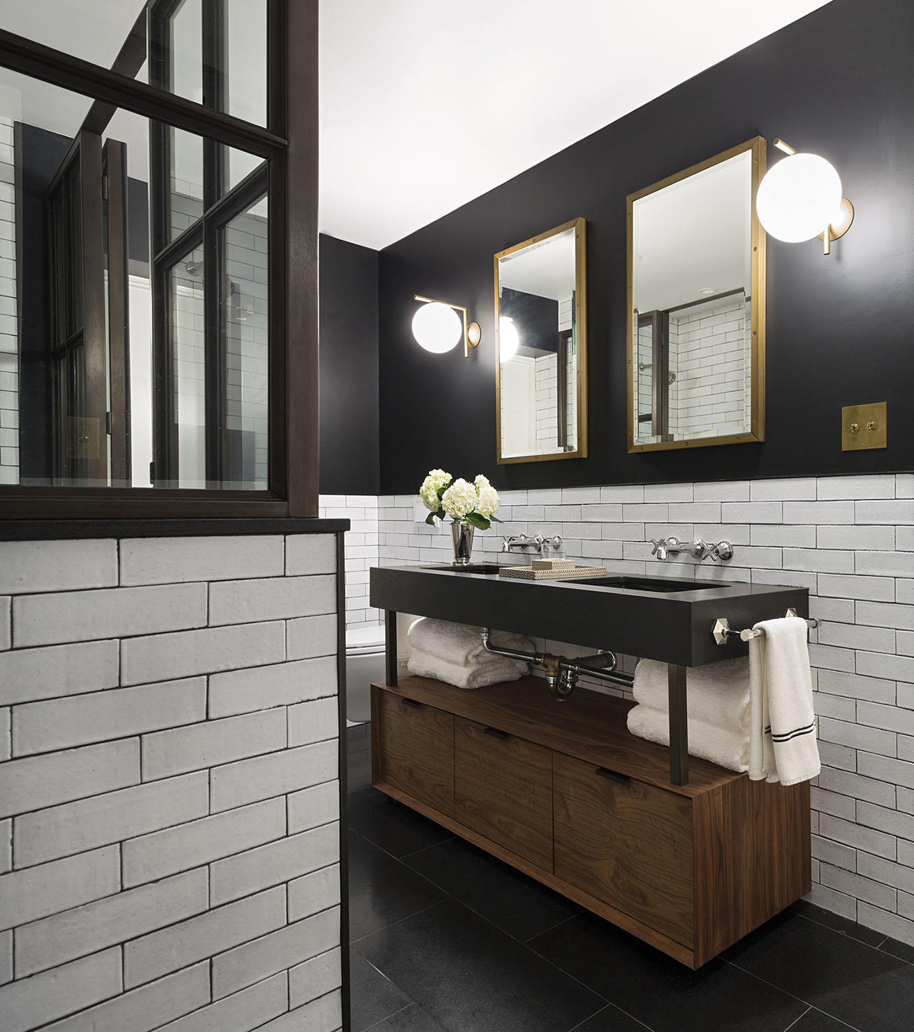 Duplex subway tile bathroom in downtown