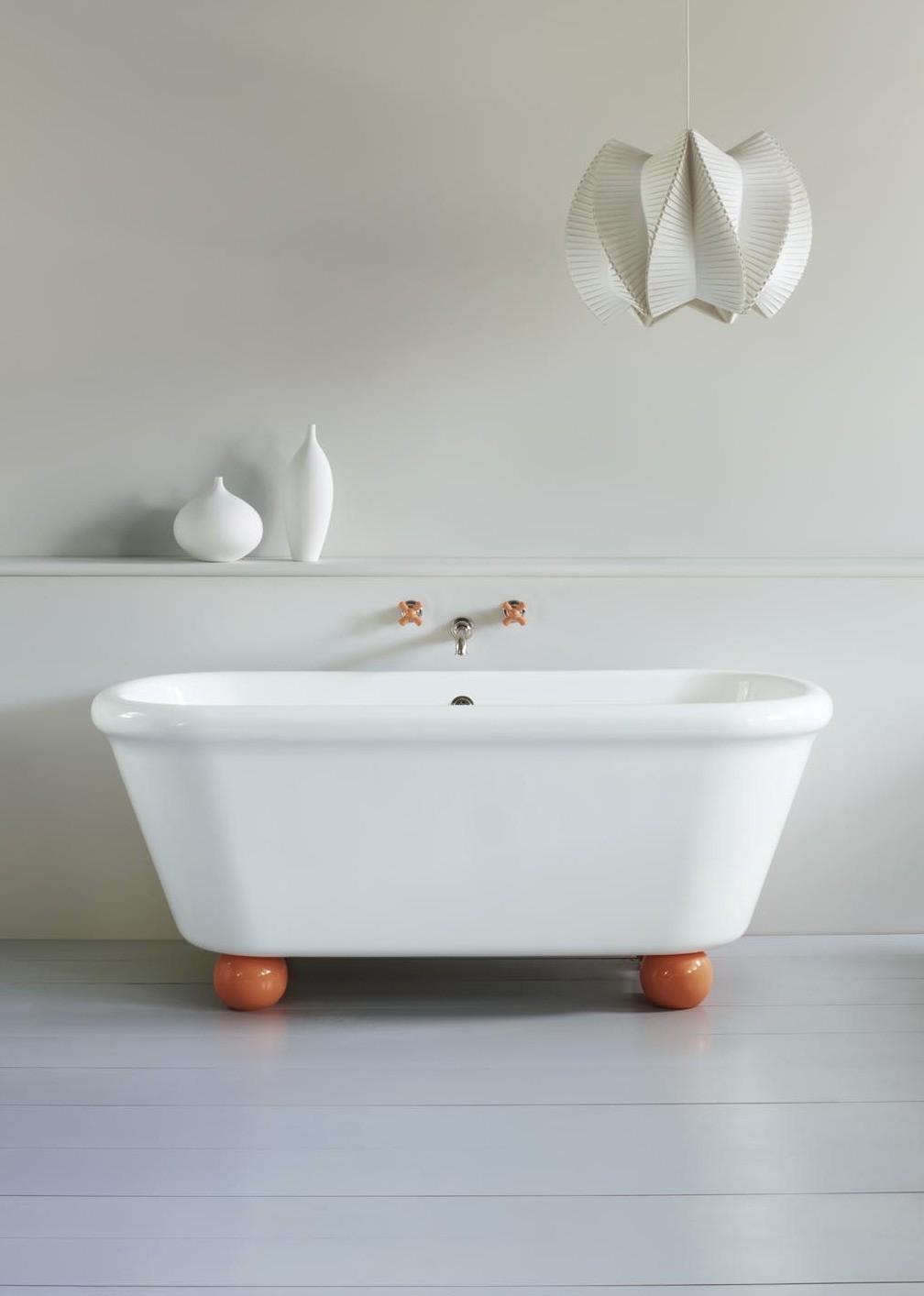 white freestanding bathtub with orange ball feet