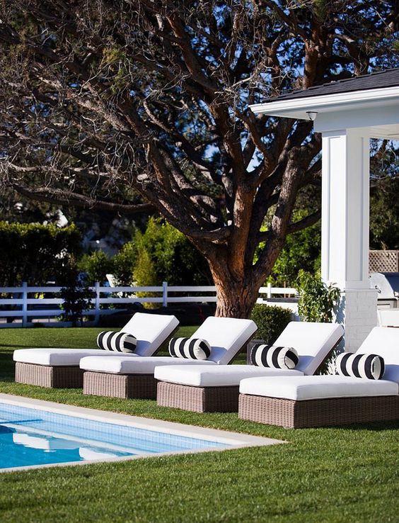 white lounge chairs black white pillows