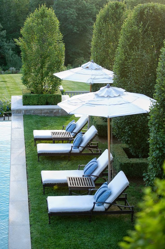 white lounge chairs striped cushions