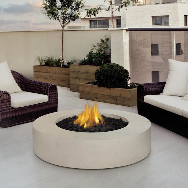 round white concrete fire pit table