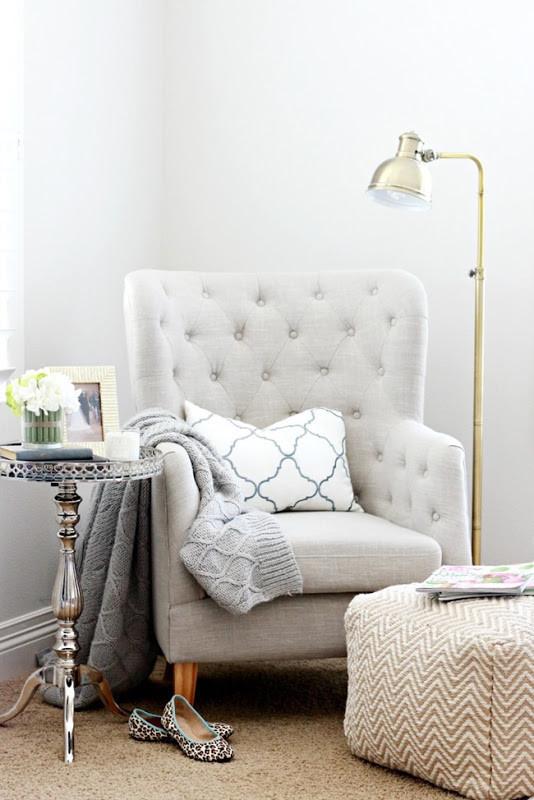 gray tufted armchair reading corner
