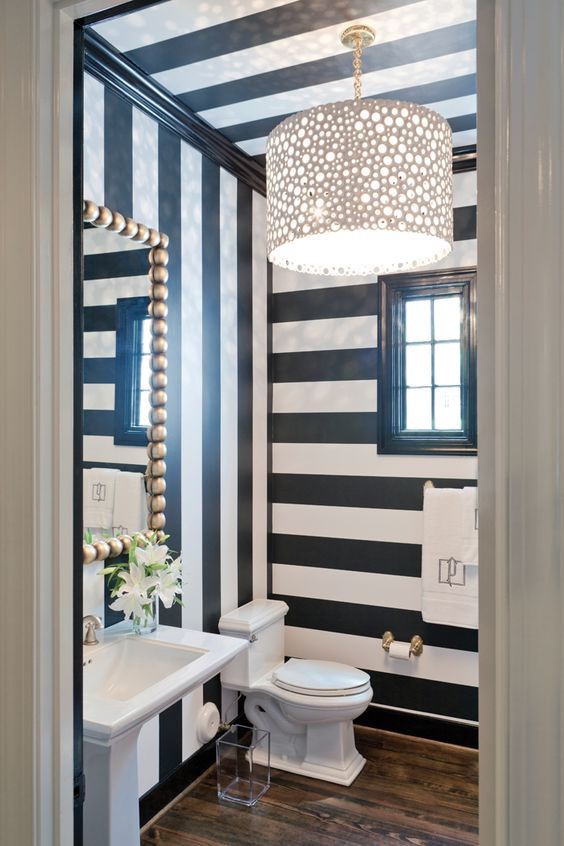black and white striped walls powder room