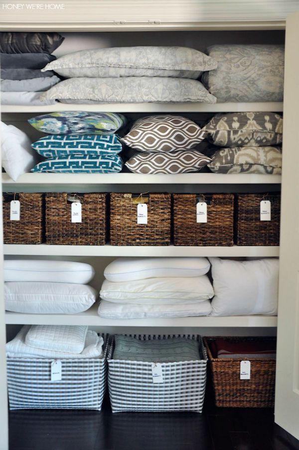 Linen closet shelves and baskets