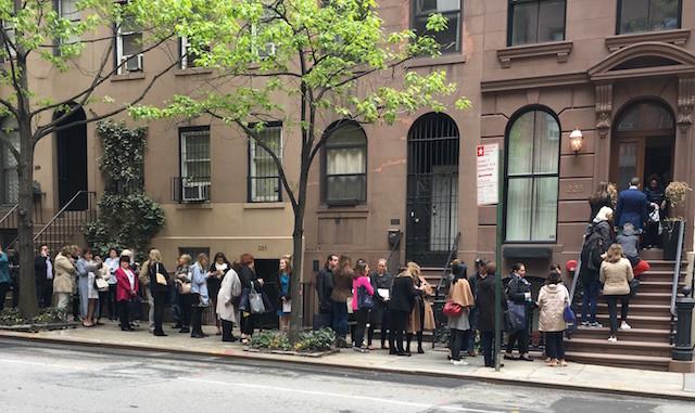 Line outside brownstone