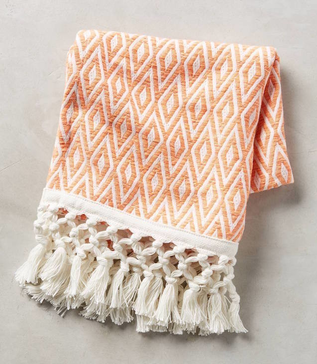 orange patterned towel with tassels