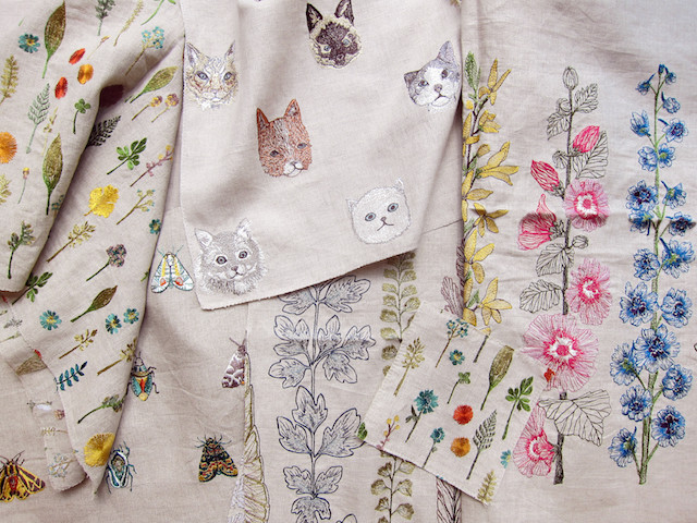 Embroidered fabric with cats and flowers