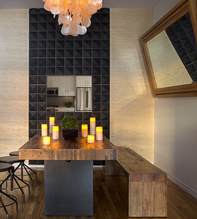 black tiled wall wooden dining table