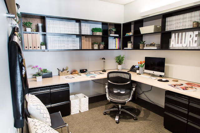 Office with built-in bookshelves and plants