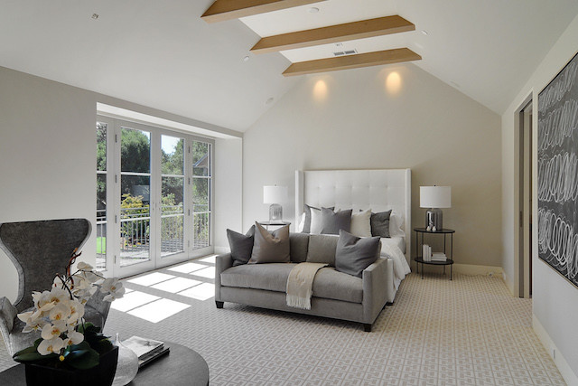 white master bedroom with vaulted ceiling
