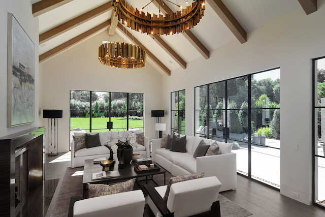 white living room with gold chandeliers